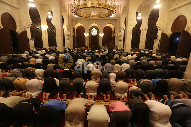"Palestinian Muslim worshipers perform ""Taraweeh"", nightly prayer of the month of Ramadan, at El Khalidi mosque, in Gaza city, on May 27, 2017. Ramadan is sacred to Muslims because it is during that month that tradition says the Koran was revealed to the Prophet Mohammed. The fast is one of the five main religious obligations under Islam. More than 1.5 billion Muslims around the world will mark the month, during which believers abstain from eating, drinking, smoking and having sex from dawn until sunset. Photo by Mohammed Asad"