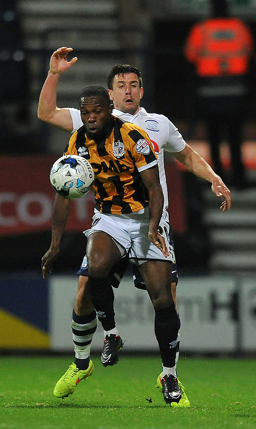 Port Vale's Mark Marshall and Preston North End's David Buchanan battle for the ball<br /> <br /> Photographer Dave Howarth/CameraSport<br /> <br /> Football - Johnstone's Paint Trophy Northern Area Second Round - Preston North End v Port Vale - Tuesday 07th October 2014 - Deepdale - Preston<br />  <br /> &copy; CameraSport - 43 Linden Ave. Countesthorpe. Leicester. England. LE8 5PG - Tel: +44 (0) 116 277 4147 - admin@camerasport.com - www.camerasport.com