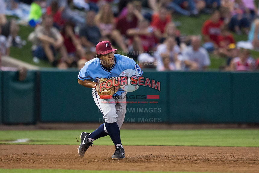 Cheslor Cuthbert (13) of the Northwest Arkansas Naturals fields a ground ball to third base during a game against the Springfield Cardinals at Hammons Field on August 23, 2013 in Springfield, Missouri. (David Welker/Four Seam Images)