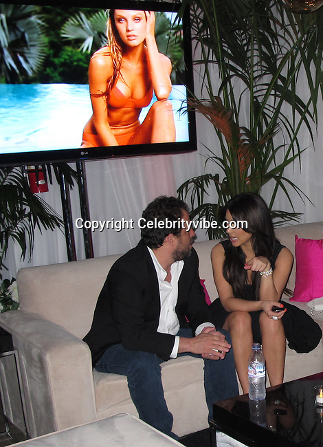 Brett Ratner and Kim Kardashian. EXCLUSIVE..VS Angels Host An Event To Celebrate The 2011 Victoria's Secret SWIM Collection- Inside..Wednesday, March 30, 2011..Club L..Hollywood, CA, USA..Photo By CelebrityVibe.com..To license this image please call (212) 410 5354; or .Email: CelebrityVibe@gmail.com ; .website: www.CelebrityVibe.com