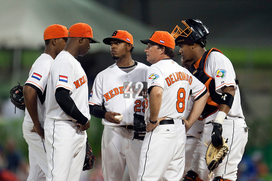 10 March 2009: Team manager Rod Delmonico of the Netherlands visits #29 Dennis Neuman on the mound along with catcher #50 Kenley Jansen during the 2009 World Baseball Classic Pool D game 5 at Hiram Bithorn Stadium in San Juan, Puerto Rico. The Netherlands pulled off second upset to advance to the secound round. The Netherlands come from behind in the bottom of the 11th inning and beat the Dominican Republic, 2-1.