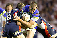 PICTURE BY ALEX WHITEHEAD/SWPIX.COM - Rugby League - Super League Play-Off - Warrington Wolves vs St Helens - The Halliwell Jones Stadium, Warrington, England - 15/09/12 - Warrington's Mike Cooper is tackled by St Helens' James Roby and Josh Perry.