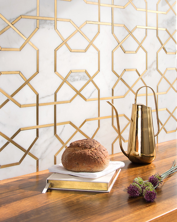 Collins, a waterjet stone mosaic, shown in honed Calacatta Gold and Brass, is part of the Trove® collection for New Ravenna.