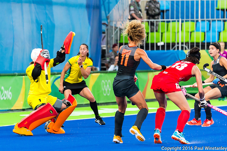 Maddie Hinch #1 of Great Britain makes the save while Maria Verschoor #11 of Netherlands and Sam Quek #13 of Great Britain watch during Netherlands vs Great Britain in the gold medal final at the Rio 2016 Olympics at the Olympic Hockey Centre in Rio de Janeiro, Brazil.