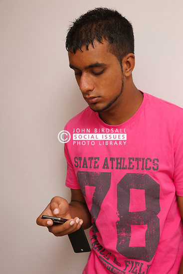 Teenager texting on  mobile phone