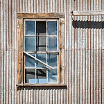 Window, corrugated wall, historic mining park, Tonopah, Nev.