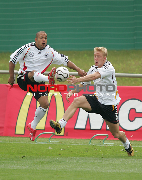 FIFA WM 2006 - Training - Germany<br /> David Odonkor and Mike Hanke (l-r) fight for the ball during a training session at the World Cup in Berlin. <br /> Foto &copy; nordphoto