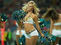 Jacksonville Jaguars Cheerleader entertains the crowd, , National Football League, International Series, Game 8, London, San Francisco 49'ers v Jacksonville Jaguars, London, Wembley Stadium, 27/10/2013 . Picture by Mark Greenwood  -Copyright:  IPS Photo Agency: Cavell Barn, The Common, Swardeston, Norwich, NR14 8DZ - Personal mobile: 07952269496