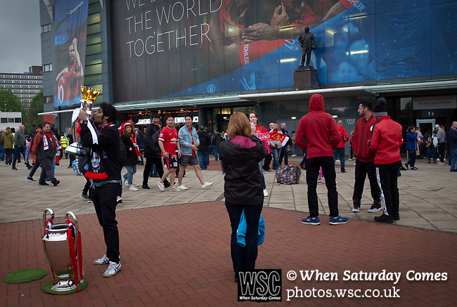 Manchester United 0, Manchester City 2, 24/04/2019. Old Trafford Stadium, English Premier League. Two home fans pictured outside the stadium on Sir Matt Busby Way before Manchester United hosted Manchester City at Old Trafford. This was the 178th time the sides had met, with City looking to overtake rivals Liverpool in the race for the English Premier League title. City won the match 2-0 watched by 74,431 spectators. Photo by Colin McPherson.