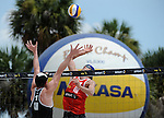 ST. PETERSBURG, FL - JUNE 18: Jacob Gibb of the USA goes up for a spike against Binstock/Schachter of Canada during the FIVB Beach Volleyball World Tour St. Petersburg Grand Slam presented by the AVP on June 18, 2015 at Spa Beach in St. Petersburg, Florida. (Photo by Donald Miralle for the AVP)