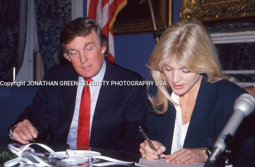 Donald Trump &amp; Marla Maples sign marriage<br /> license at City Hall NYC By Jonathan Green