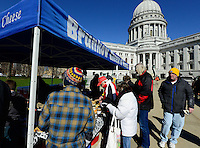 Visitors sample Brunkow cheese at opening day of the Dane County Farmer's Market on Saturday, April 20, 2013, in Madison, Wisconsin