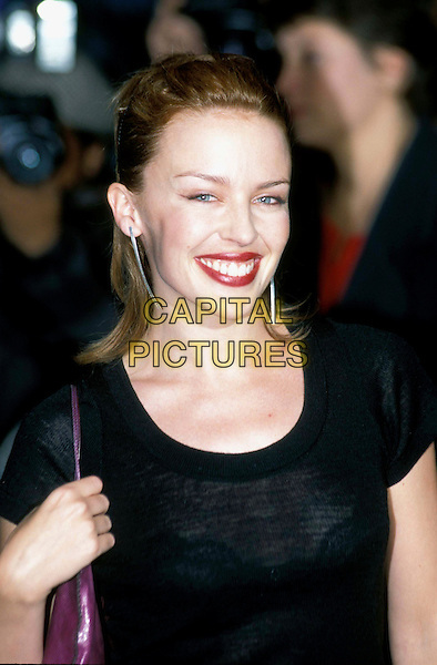 KYLIE MINOGUE.Ref: 6887 .red lipstick, dangly earrings, headshot, portrait.*RAW SCAN - photo will be adjusted for publication*.www.capitalpictures.com.sales@capitalpictures.com.© Capital Pictures