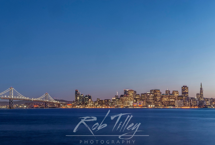 USA, CA, San Francisco, Bay Bridge & Downtown Skyline at Twilight
