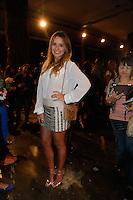 SAO PAULO, SP, 19 DE MARÇO DE 2013. SPFW - PRIMAVERA VERAO 2013 - FORUM.A cantora Aeileen Kunkel aguarda o inicio do desfile primavera/verão 2014 da marca .FORUM , no segundo dia de desfiles DA SPFW, no Pavilhão da Bienal.   a cantora usa blusaa Pop Store; Sandalia Schultz, bolsa Chanel e joias Krystel Bianco..FOTO ADRIANA SPACA/BRAZIL PHOTO PRESS