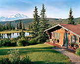 USA, Alaska, Camp Denali Lodge by Nugget Lake with Mount Denali in background, Denali National Park