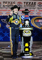 Nov. 8, 2009; Fort Worth, TX, USA; NASCAR Sprint Cup Series driver Kurt Busch celebrates after winning the Dickies 500 at the Texas Motor Speedway. Mandatory Credit: Mark J. Rebilas-
