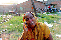A woman cries as she speaks on the phone in front of the collapsed Rana Plaza complex in Savar. A large crowd of onlookers gathers in front of the collapsed Rana Plaza complex in Savar. The 8 storey building, which housed a number of garment factories employing over 3,000 workers, collapsed on 24 April 2013. By 29 April, at least 380 were known to have died while hundreds remained missing. Workers who were worried about going to work in the building when they noticed cracks in the walls were told not to worry by the building's owner, Mohammed Sohel Rana, who is a member of the ruling Awami League's youth front. He fled his home and tried to escape to neighbouring India after the building collapsed but was caught by police and brought back to Dhaka. Some of the factories working in the Rana Plaza building produce cheap clothes for various European retailers including Primark in the UK and Mango, a Spanish label. . /Felix Features