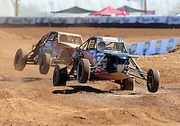 Apr 16, 2011; Surprise, AZ USA; LOORRS driver Mike Porter (8) leads Rich Ronco (99) during round 3 at Speedworld Off Road Park. Mandatory Credit: Mark J. Rebilas-.