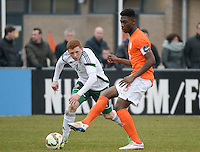 20150314 - GENDT , NETHERLANDS  : Dutch Timothy Fosu-Mensah (right) pictured with Northern Irish Shane Lavery (left) during the soccer match between Under 17 teams of  The Netherlands and Northern Ireland , on the second matchday in group 3 of the UEFA Elite Round Under 17 at De Bataven Stadion , Gendt , The Netherlands . Saturday  14 th March 2015 . PHOTO DAVID CATRY