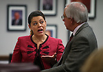 Nevada Assembly members Teresa Benitez Thompson, D-Reno, and Pat Hickey, R-Reno, talk at the Legislative Building in Carson City, Nev., on Wednesday, April 29, 2015. <br /> Photo by Cathleen Allison