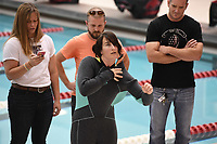 NWA Democrat-Gazette/J.T. WAMPLER Lindsay Scott of Farmington sets a Guinness World Record for the fastest time to put on and take off a wetsuit Sunday Nov. 5, 2017 in Fayetteville.