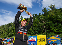 Jun 18, 2017; Bristol, TN, USA; NHRA top fuel driver Clay Millican celebrates after winning the Thunder Valley Nationals at Bristol Dragway. It is the first victory of his NHRA career. Mandatory Credit: Mark J. Rebilas-USA TODAY Sports