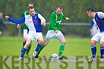 Tom Duffy Ballina tries to nip the ball away from Castleisland Sean Óg O'Ciarbdubhain during their FAI cup clash in Tralee on Sunday