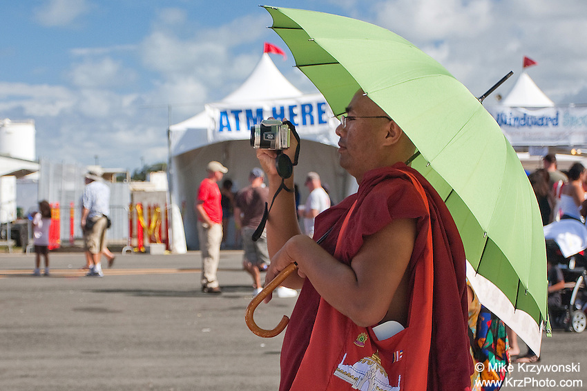 Buddhist monk taking a photo w/ camera at the Kaneohe Air Show, Oahu, Hawaii