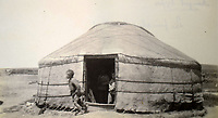 BNPS.co.uk (01202 558833)<br /> Pic: ClevedonAuctionRooms/BNPS<br /> <br /> A traditional nomadic Yurt.<br /> <br /> Rev Francis John Griffith travelled as a Missionary aroud Outer Mongolia in the 1920's.<br /> <br /> A fascinating collection of early 20th century photos of Mongolia and China which were taken by a British vicar doing missionary work have been unearthed after 97 years.<br /> <br /> Through his famine relief work Reverend Francis John Griffith was able to get a remarkable insight into the lives of the native population and their nomadic existence.<br /> <br /> His encounters were captured using a handheld camera that he carried with him at all times.<br /> <br /> In one image a family goes about its business outside the hut that is their home, while another image is of a man riding a camel which was the typical method of transport.<br /> <br /> Revd Griffith was able to get native elders to sit for him in portraits and there are intimate snaps of women and children wearing elaborate native headdresses.<br /> <br /> As well as the people, Revd Griffith took an interest in the surroundings and photographed temples and prominent buildings in addition to the vast, desert landscape.