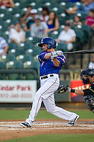 Round Rock Express outfielder Ryan Strausborger (6) follows through on his swing during the Pacific Coast League baseball game against the Omaha Storm Chasers on June 1, 2014 at the Dell Diamond in Round Rock, Texas. The Express defeated the Storm Chasers 11-4. (Andrew Woolley/Four Seam Images)