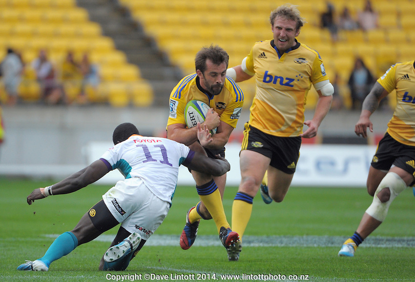Conrad Smith in action during the Super Rugby match between the Hurricanes and Cheetahs at Westpac Stadium, Wellington, New Zealand on Saturday, 15 March 2014. Photo: Dave Lintott / lintottphoto.co.nz