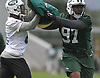 Lawrence Thomas #97, New York Jets defensive lineman, right, muscles his way past a block during the first day of offseason training activity at the Atlantic Health Jets Training Center in Florham Park, NJ on Tuesday, May 23, 2017.