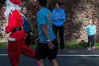 CIM runner in Santa outfit brings wonder to the face of a young observer.