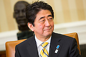 Prime Minister Shinzo Abe of Japan speaks to the media during a photo-op in the Oval Office of the White House in Washington, D.C. following a bilateral meeting with United States President Barack Obama (not pictured) on Friday, February 22, 2013. .Credit: Kristoffer Tripplaar  / Pool via CNP