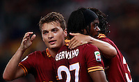 Calcio, Serie A: Roma vs Milan. Roma, stadio Olimpico, 25 aprile 2014.<br /> AS Roma forward Gervinho, of Ivory Coast, center, celebrates with teammates Adem Ljajic, of Serbia, left, and  Dodo', of Brazil, after scoring during the Italian Serie A football match between AS Roma and AC Milan at Rome's Olympic stadium, 25 April 2014.<br /> UPDATE IMAGES PRESS/Isabella Bonotto