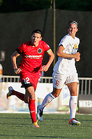 Rochester, NY - Friday June 17, 2016: Portland Thorns FC forward Christine Sinclair (12), Western New York Flash midfielder Abby Erceg (6) during a regular season National Women's Soccer League (NWSL) match between the Western New York Flash and the Portland Thorns FC at Rochester Rhinos Stadium.
