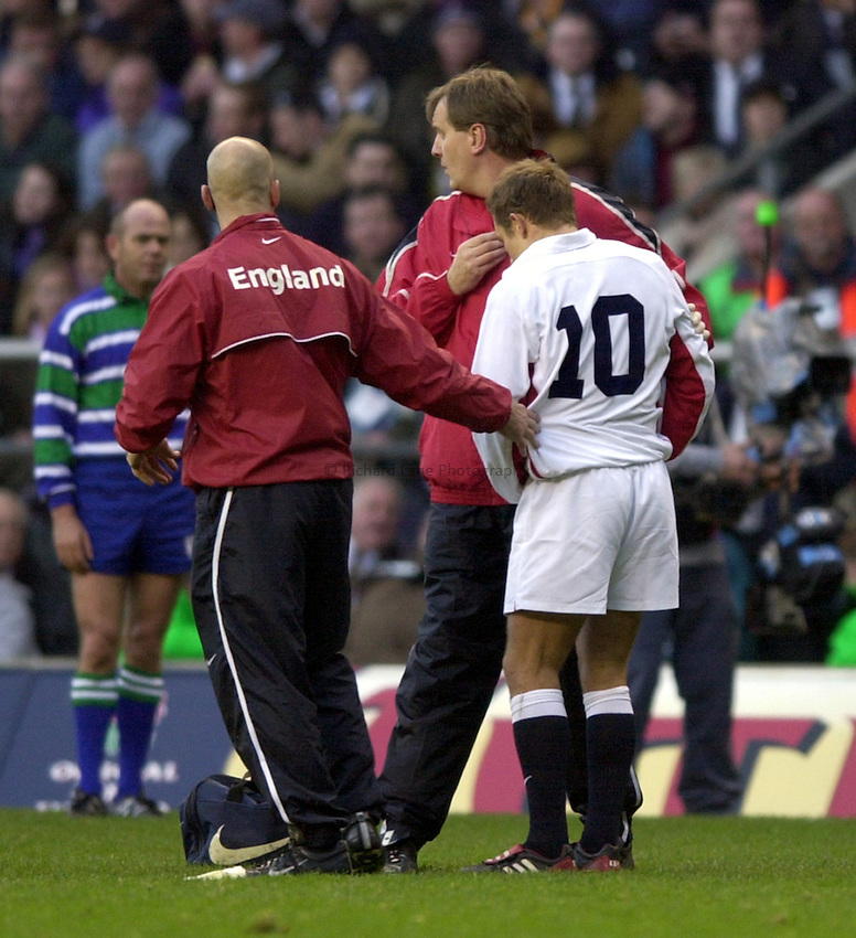 Photo: Richard Lane..England v South Africa. Investec Challenge at Twickenham. 23/11/2002..Jonny Wilkinson leaves the field injured.