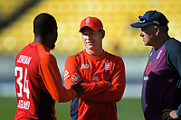 England's Chris Jordan (left) talks to captain Eoin Morgan and coach Chris Silverwood (right) after the Twenty20 International cricket match between NZ Black Caps and England at Westpac Stadium in Wellington, New Zealand on Sunday, 3 November 2019. Photo: Dave Lintott / lintottphoto.co.nz