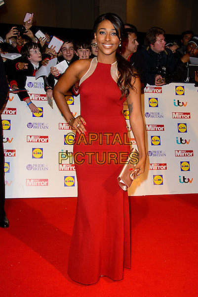 Alexandra Burke<br /> The Daily Mirror's Pride of Britain Awards arrivals at the Grosvenor House Hotel, London, England.<br /> 7th October 2013<br /> full length hand on hip red gold sleeveless dress clutch bag white sheer <br /> CAP/CJ<br /> &copy;Chris Joseph/Capital Pictures