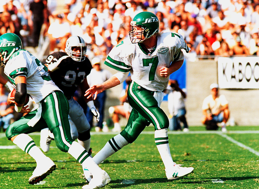 "Quarterback Norman Julius ""Boomer"" Esiason of the New York Jets plays in a NFL game against the Los Angeles Raiders in the Los Angeles Coliseum in 1993."