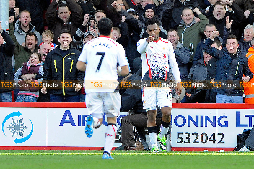 Daniel Sturridge of Liverpool celebrates with Luis Su?rez of Liverpool - AFC Bournemouth vs Liverpool - FA Cup 4th Round Football at the Goldsands Stadium, Bournemouth, Dorset - 25/01/14 - MANDATORY CREDIT: Denis Murphy/TGSPHOTO - Self billing applies where appropriate - 0845 094 6026 - contact@tgsphoto.co.uk - NO UNPAID USE