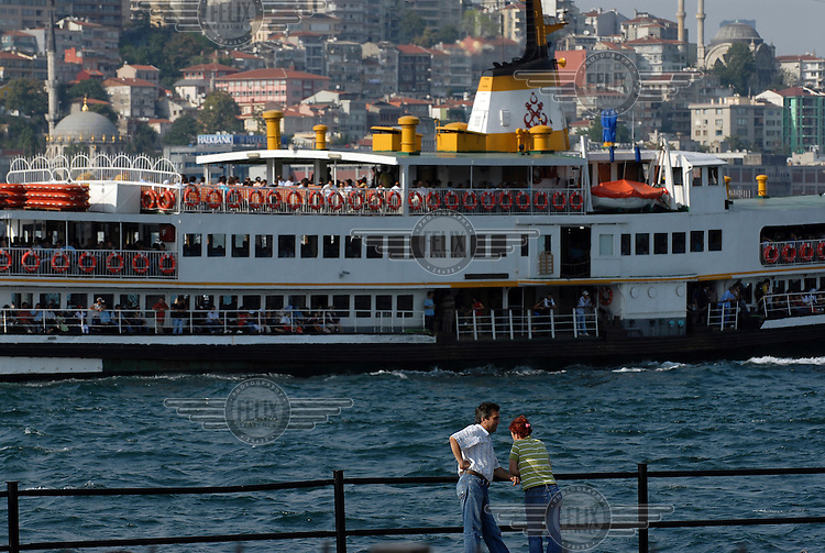Ferry and the Beyoglu skyline seen from the Eminonu district of Istanbul.  .