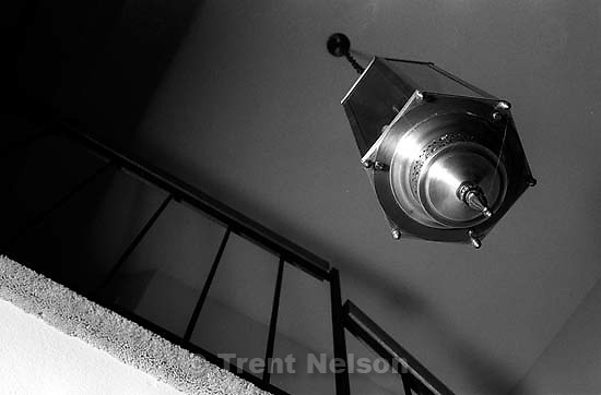 Lamp and bannister in the Nelson house.<br />