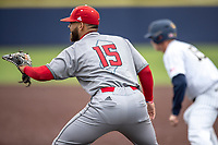 Rutgers Scarlet Knights first baseman Chris Brito (15) hold a base runner on against the Michigan Wolverines on April 27, 2019 in the NCAA baseball game at Ray Fisher Stadium in Ann Arbor, Michigan. Michigan defeated Rutgers 10-1. (Andrew Woolley/Four Seam Images)