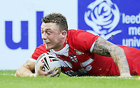 PICTURE BY CHRIS MANGNALL /SWPIX.COM...Rugby League - International Origin Match  - England v Exiles - Galpharm Stadium, Huddersfield, England  - 04/07/12... England's  2nd Try Josh Charnley scores