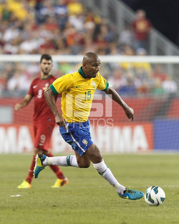 Brazil defender Maicon (15) drives for the net.  In an international friendly, Brazil (yellow/blue) defeated Portugal (red), 3-1, at Gillette Stadium on September 10, 2013.