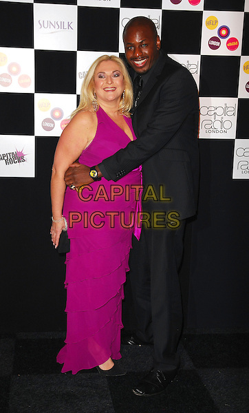 VANESSA FELTZ & GUEST.At the Capital Rocks! Party, .Battersea Park Events Arena, London, .England, December 12th 2006..full length pink purple dress partner couple.CAP/CAN.©Can Nguyen/Capital Pictures