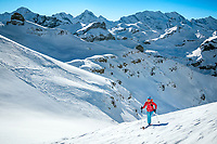 Ski touring on the Schwalmerer with evidence of an avalanche below, above Lauterbrunnen Valley, Switzerland