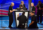 Stagehands position the logo on the podium prior to the opening session of the 2016 Democratic National Convention at the Wells Fargo Center in Philadelphia, Pennsylvania on Monday, July 25, 2016.<br /> Credit: Ron Sachs / CNP<br /> (RESTRICTION: NO New York or New Jersey Newspapers or newspapers within a 75 mile radius of New York City)